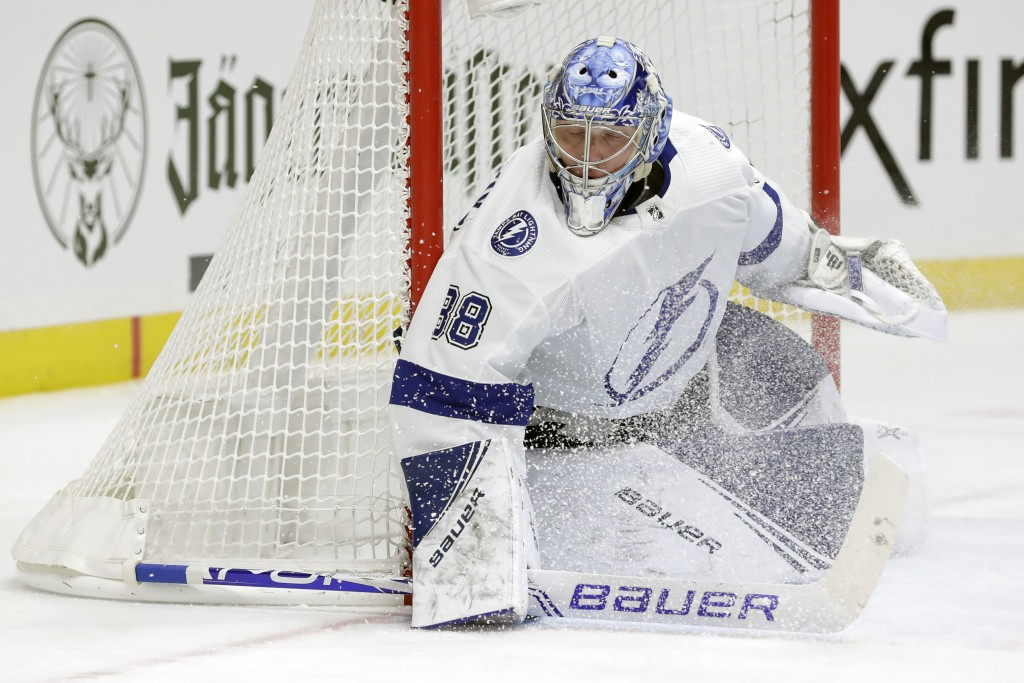Tampa Bay Lightning goaltender Andrei Vasilevskiy, of Russia, plays against the Nashville Predators in the second period of an NHL hockey game Tuesday...