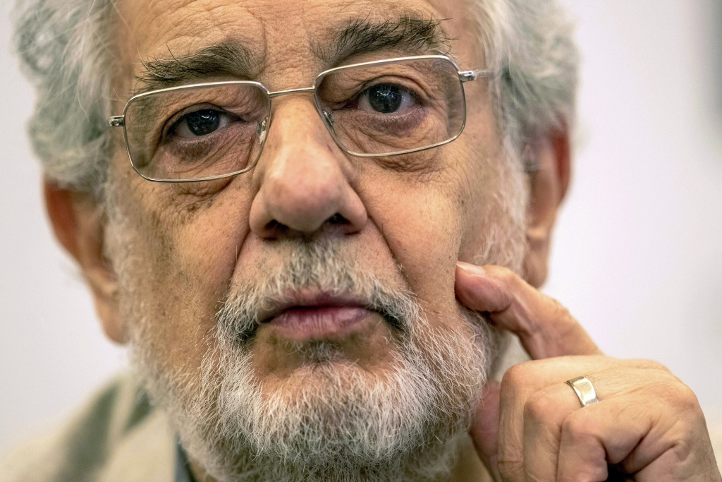 "FILE - In this July 12, 2019, file photo, opera singer Placido Domingo speaks during a news conference about his upcoming show ""Giovanna d'Arco"" in Ma..."