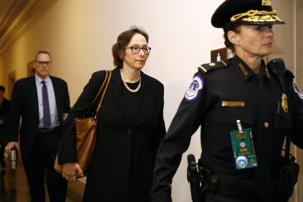 Constitutional law expert, Stanford Law School professor Pamela Karlan, center, arrives to testify at a hearing before the House Judiciary Committee o...