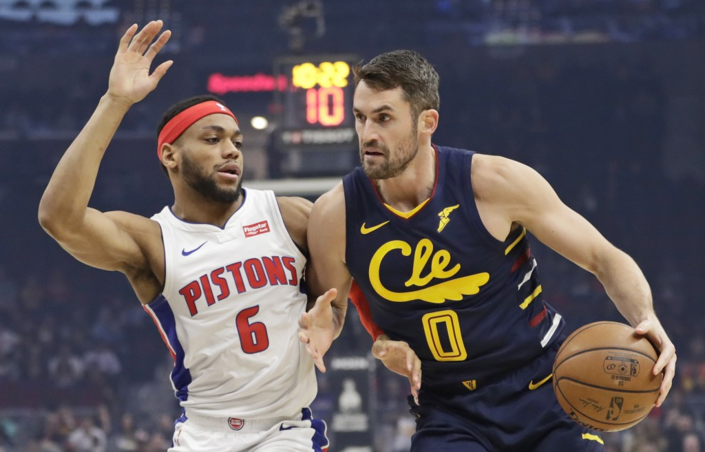 Cleveland Cavaliers' Kevin Love (0) drives against Detroit Pistons' Bruce Brown (6) in the first half of an NBA basketball game, Tuesday, Dec. 3, 2019...