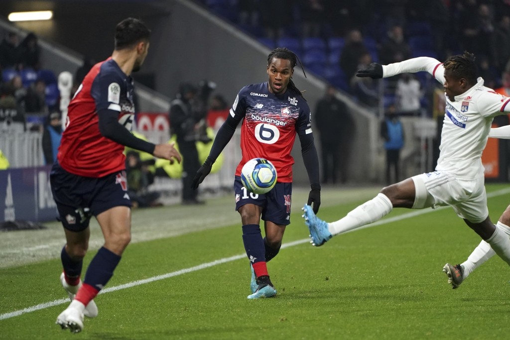 Lille's Renato Luz Sanches, center, challenges for the ball with Lyon's Youssouf Kone, right, during the French League One soccer match between Lyon a...