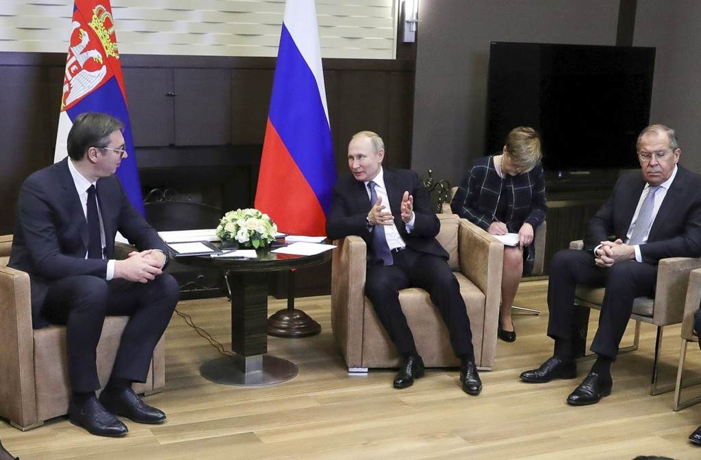 Russian President VladimirPutin, center, speaks to Serbian President Aleksandar Vucic, left, as Russian Foreign Minister Sergey Lavrov, right, attend...