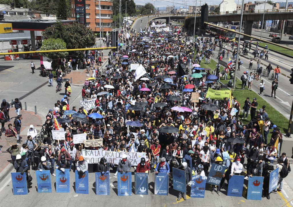 Anti-government demonstrators march during a national strike in Bogota, Colombia, Wednesday, Dec. 4, 2019. Colombia's recent wave of demonstrations be...