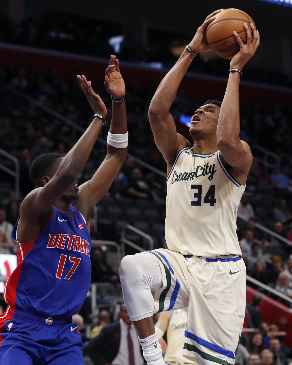 Milwaukee Bucks forward Giannis Antetokounmpo (34) attempts a layup as Detroit Pistons guard Tony Snell (17) defends during the first half of an NBA b...
