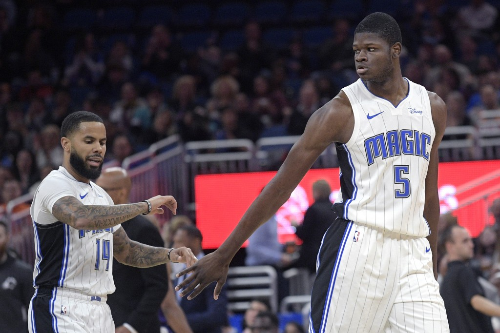 Orlando Magic center Mo Bamba (5) is congratulated by guard D.J. Augustin (14) after Bamba made a three-point shot during the first half of an NBA bas...