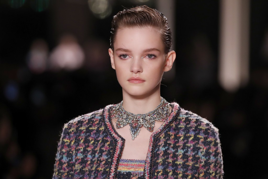 A model wears a creation for Chanel's Metiers d'Art collection presented at the Grand Palais in Paris, Wednesday, Dec.4, 2019. (AP Photo/Francois Mori...
