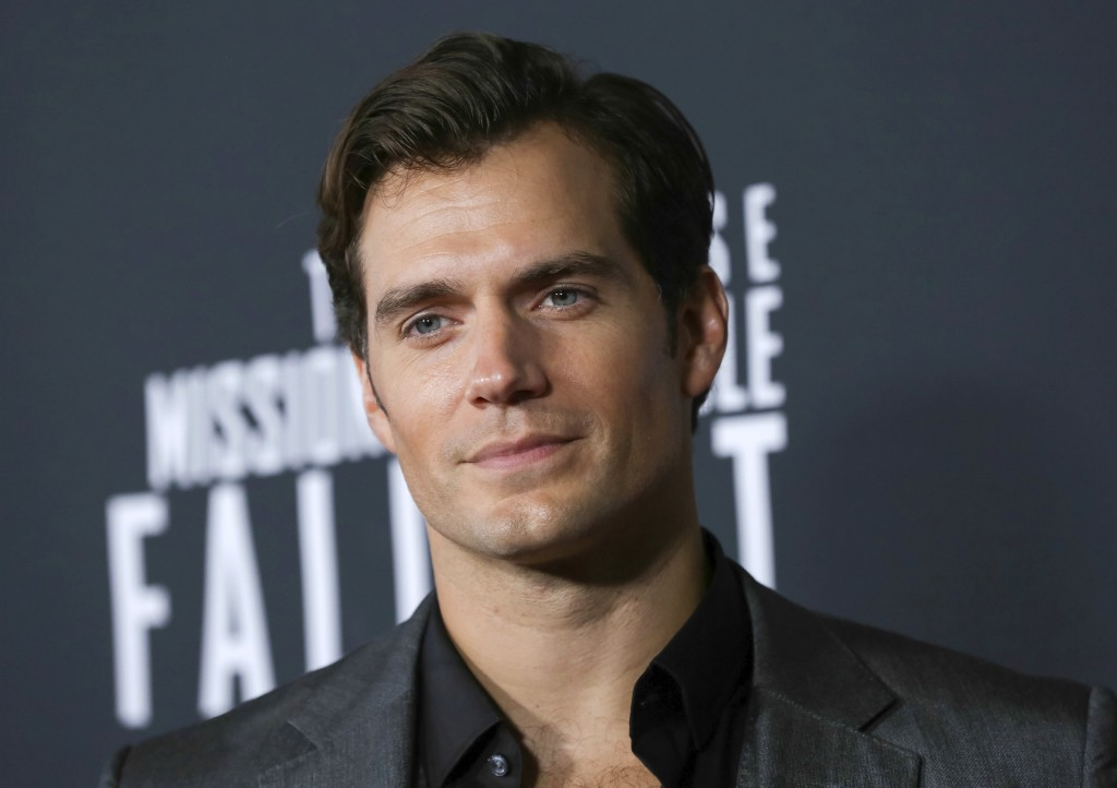 """FILE - In this July 22, 2018 file photo, actor Henry Cavill attends the U.S. premiere of """"Mission: Impossible - Fallout"""" in Washington. Cavill dons a ..."""