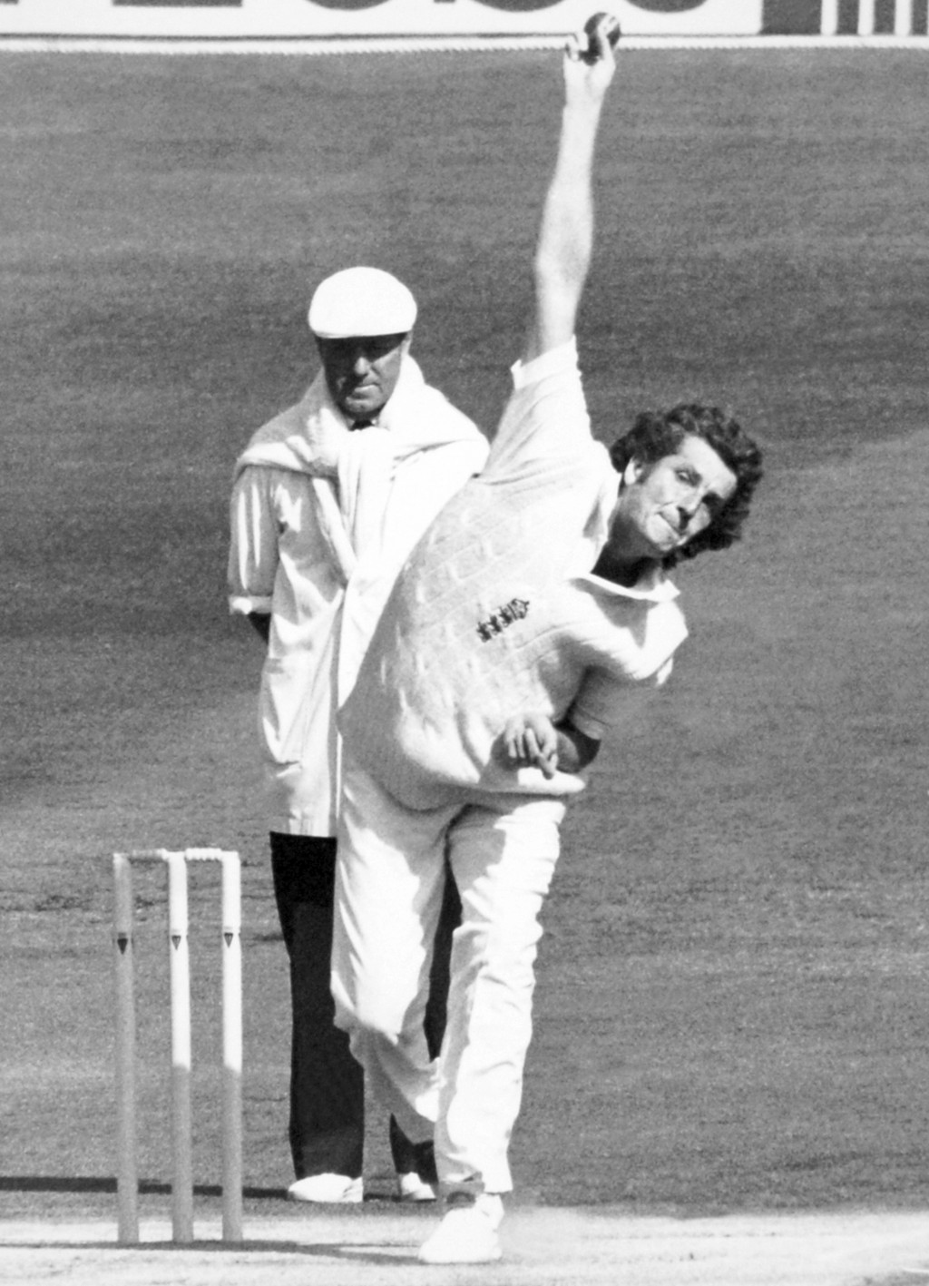 FILE - In this file photo dated June 3, 1983, showing England and Warwickshire fast bowler Bob Willis, watched by umpire Bill Alley. Former England ca...