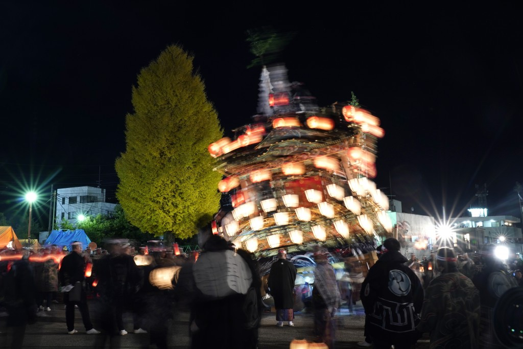 In this Tuesday, Dec. 3, 2019, photo,  a lantern-covered float leans as it goes to the town central square during the Chichibu Night Festival in Chich...