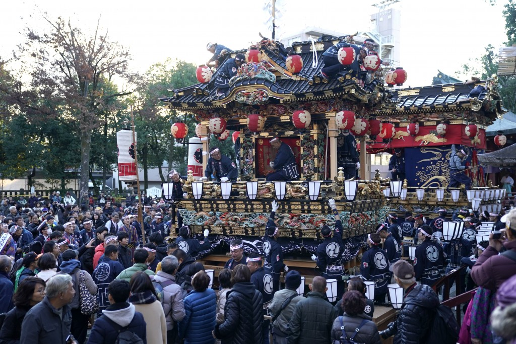 In this Tuesday, Dec. 3, 2019, photo, participants clad in traditional happi coats put lanterns on floats before it goes to the town central square du...