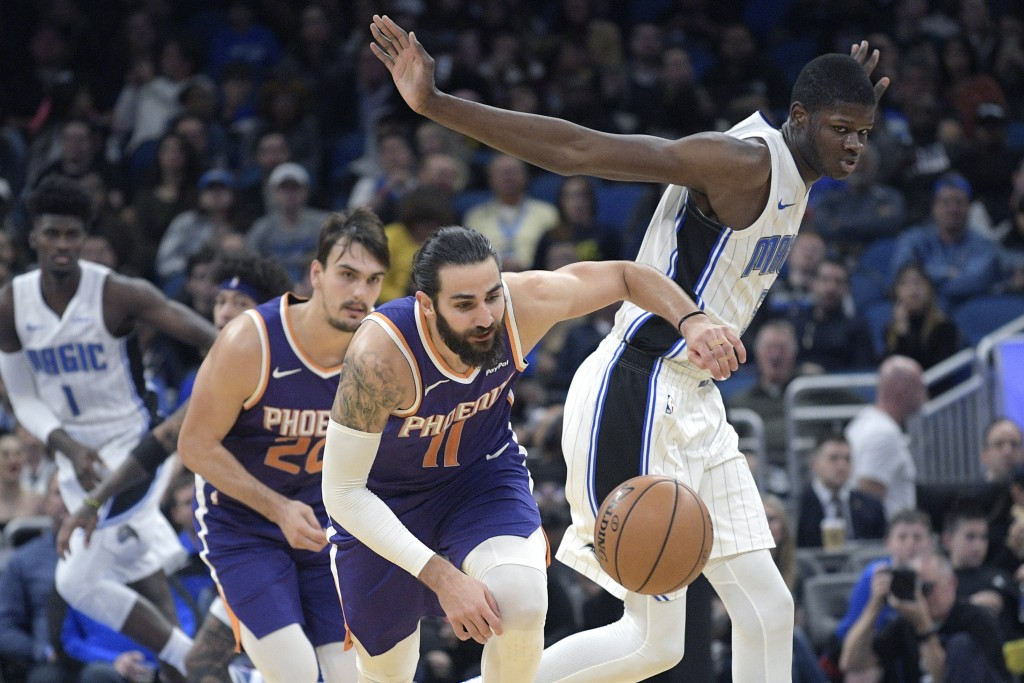 Phoenix Suns guard Ricky Rubio (11) steals the ball from Orlando Magic center Mo Bamba, right, during the first half of an NBA basketball game Wednesd...