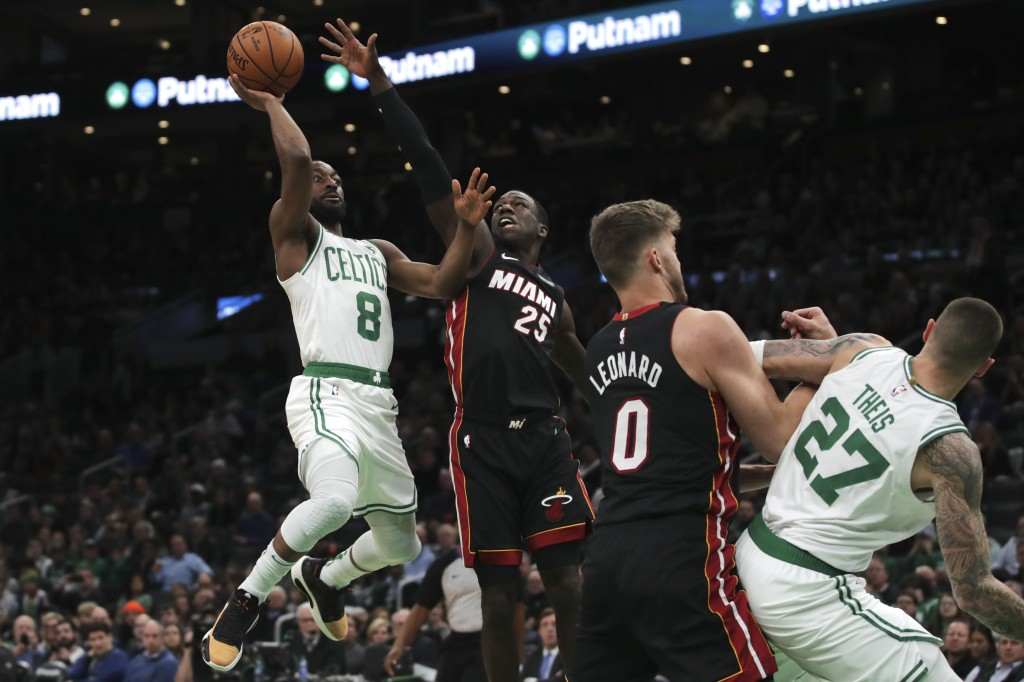 Boston Celtics guard Kemba Walker (8) drives to the basket against Miami Heat guard Kendrick Nunn (25) during the first half of an NBA basketball game...