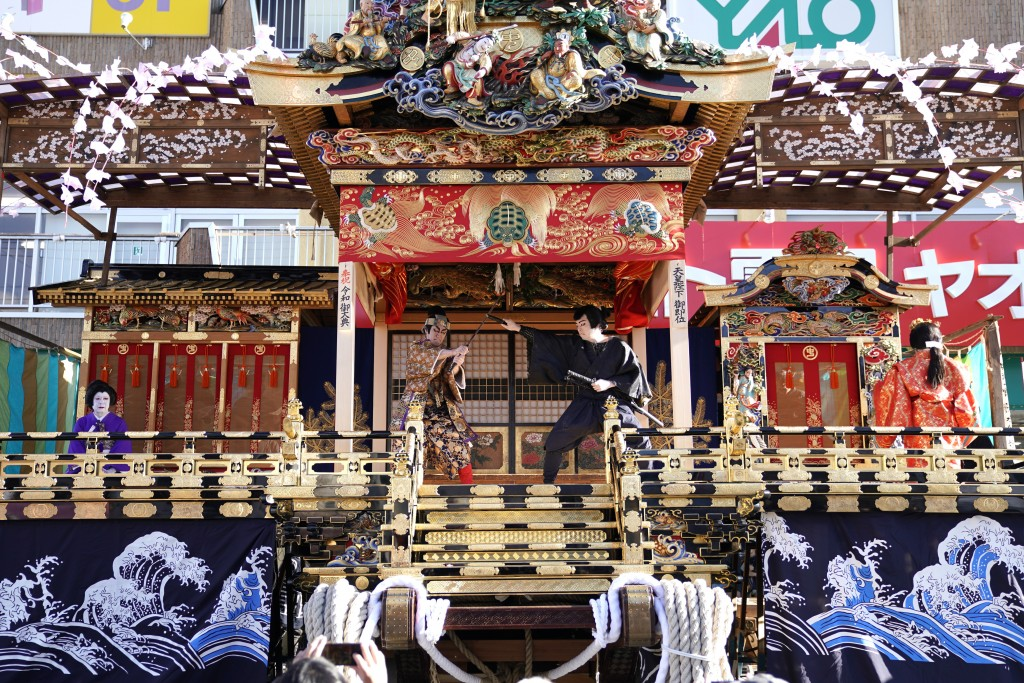 In this Tuesday, Dec. 3, 2019, photo, local residents perform kabuki inside a float for the Chichibu Night Festival in Chichibu, Japan. This two-day f...