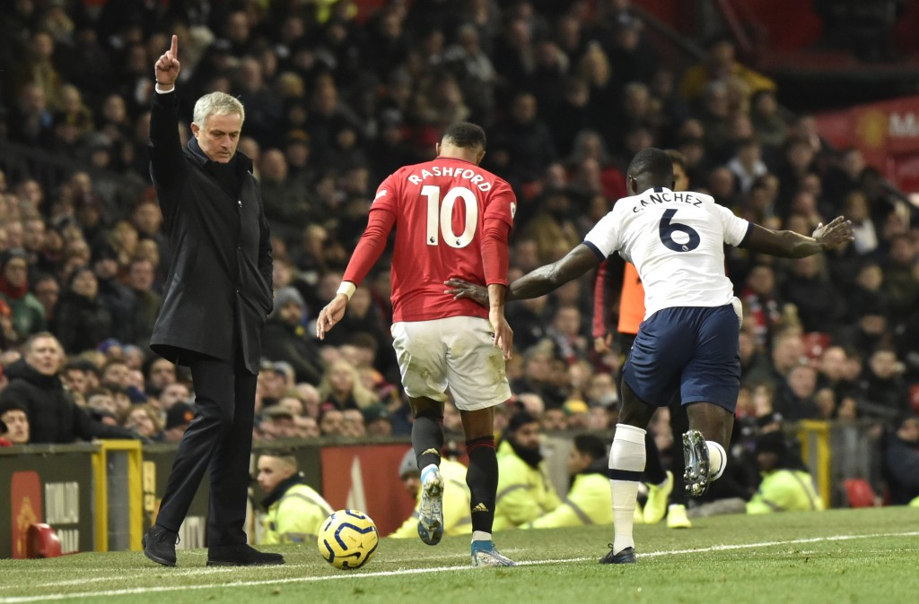 Tottenham's manager Jose Mourinho, left, reacts as Manchester United's Marcus Rashford, centre, and Tottenham's Davinson Sanchez challenge for the bal...