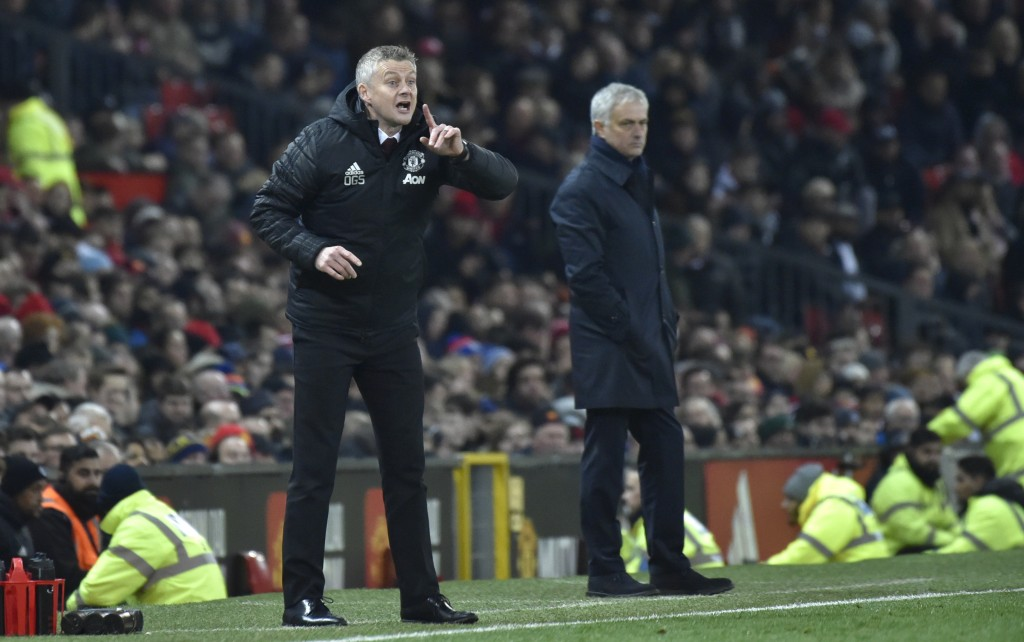 Manchester United's manager Ole Gunnar Solskjaer, left, gives instructions from the side line as Tottenham's manager Jose Mourinho looks on during the...