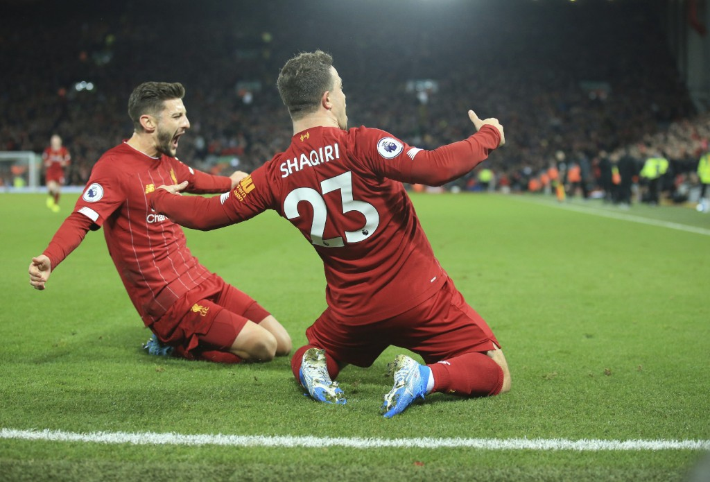 Liverpool's Xherdan Shaqiri, right, celebrates his goal against Everton during the English Premier League soccer match between Liverpool and Everton a...