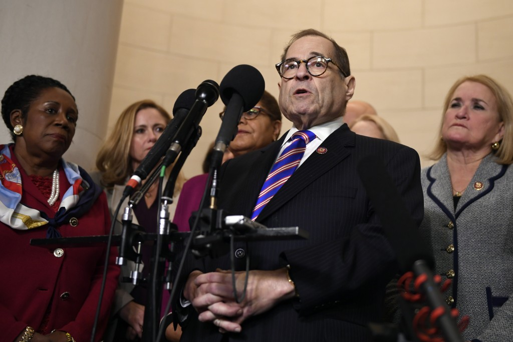 House Judiciary Committee Chairman Jerrold Nadler, D-N.Y., standing with other committee Democrats, talks to reporters following the House Judiciary C...