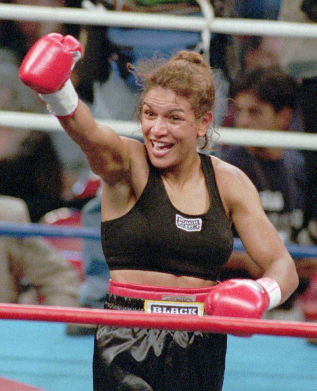 FILE - In this Sept. 13, 1997, file photo, Lucia Rijker, of the Netherlands, gestures after beating Andrea Deshong in a boxing match in Las Vegas. Rij...