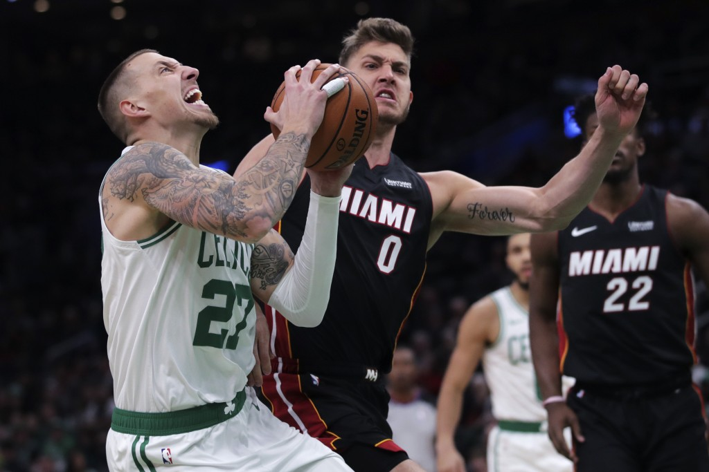 Boston Celtics forward Daniel Theis (27) drives to the basket against Miami Heat forward Meyers Leonard (0) during the first half of an NBA basketball...