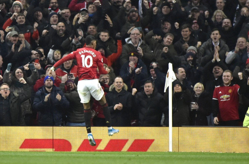 Manchester United's Marcus Rashford celebrates after scoring his side's second goal during the English Premier League soccer match between Manchester ...