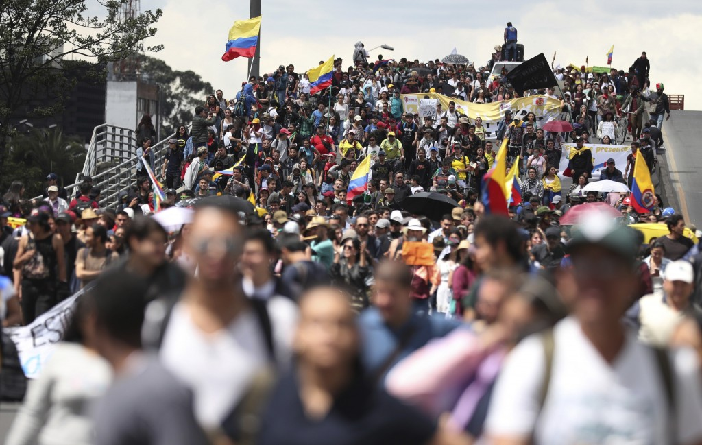 Anti-government demonstrators march in Bogota, Colombia, Wednesday, Dec. 4, 2019. Colombia's recent wave of demonstrations began with a massive strike...