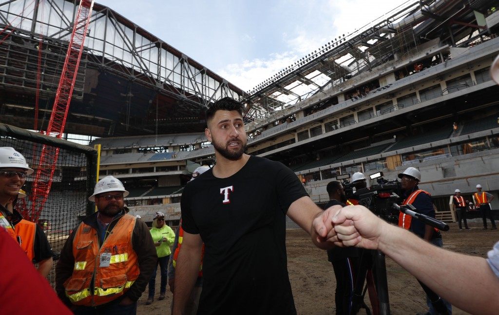 Texas Rangers Joey Gallo is greeted after a batting practice at the under construction baseball field at the new Rangers stadium in Arlington, Texas, ...