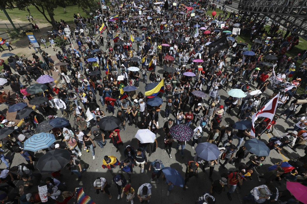 Demonstrators march during a national strike in Bogota, Colombia, Wednesday, Dec. 4, 2019. Colombia's recent wave of demonstrations began with a massi...
