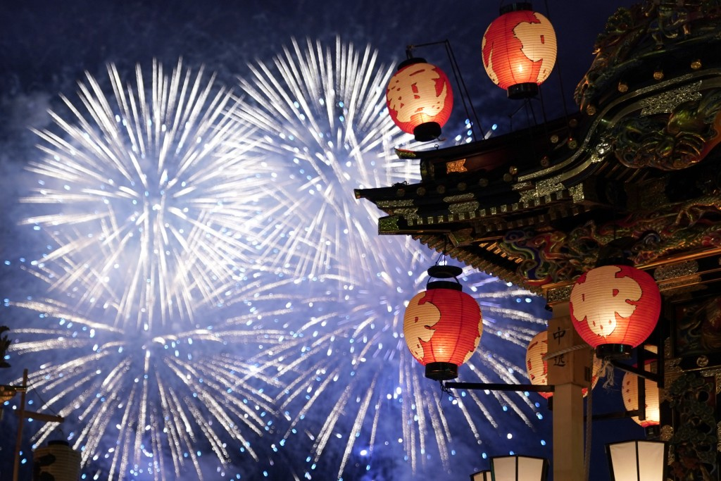 In this Tuesday, Dec. 3, 2019, photo, a lantern-covered float stands as fireworks light up the sky during the Chichibu Night Festival in Chichibu, Jap...
