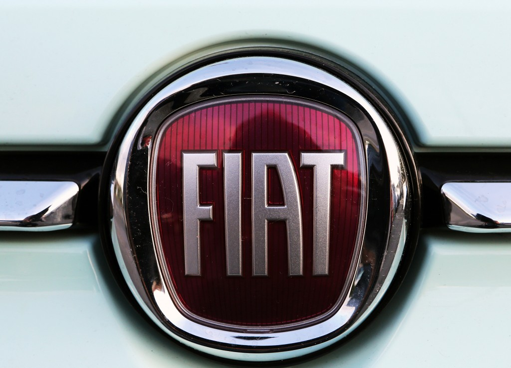 FILE - In this Oct. 31, 2019 file photo, a Fiat logo is pictured on a car in Bayonne, southwestern France. Union leaders from Fiat Chrysler factories ...