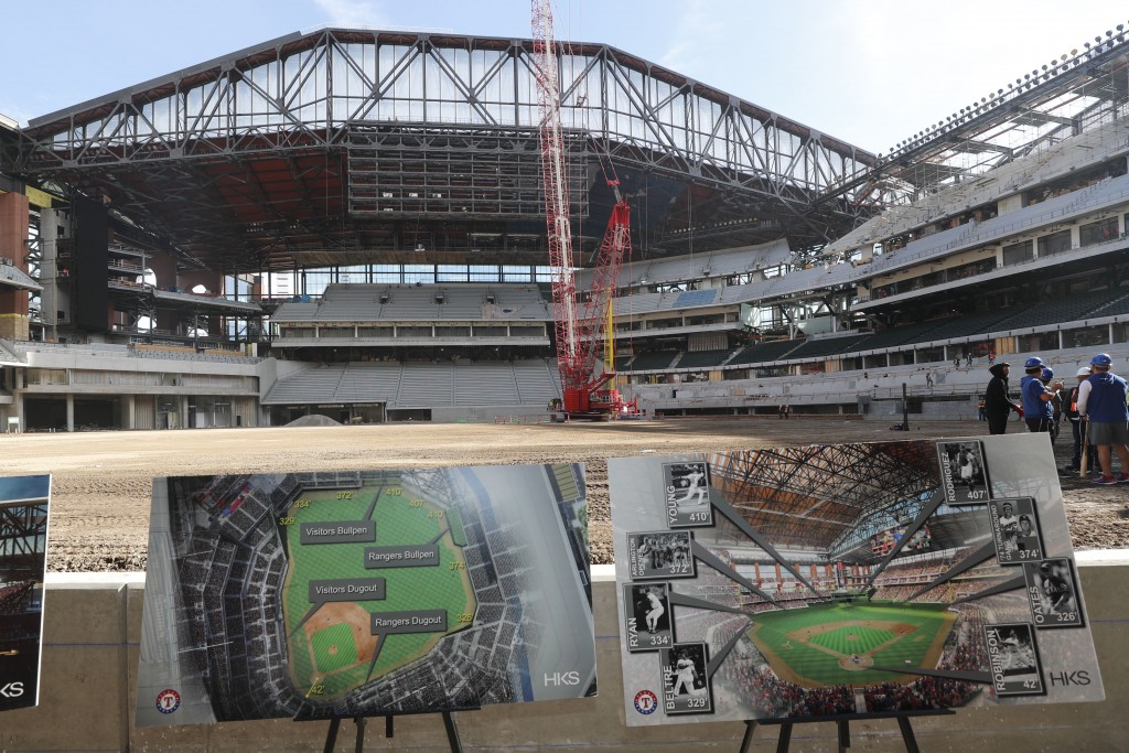Illustrations in the foreground show information about the under construction baseball field at the new Texas Rangers stadium in Arlington, Texas, Wed...