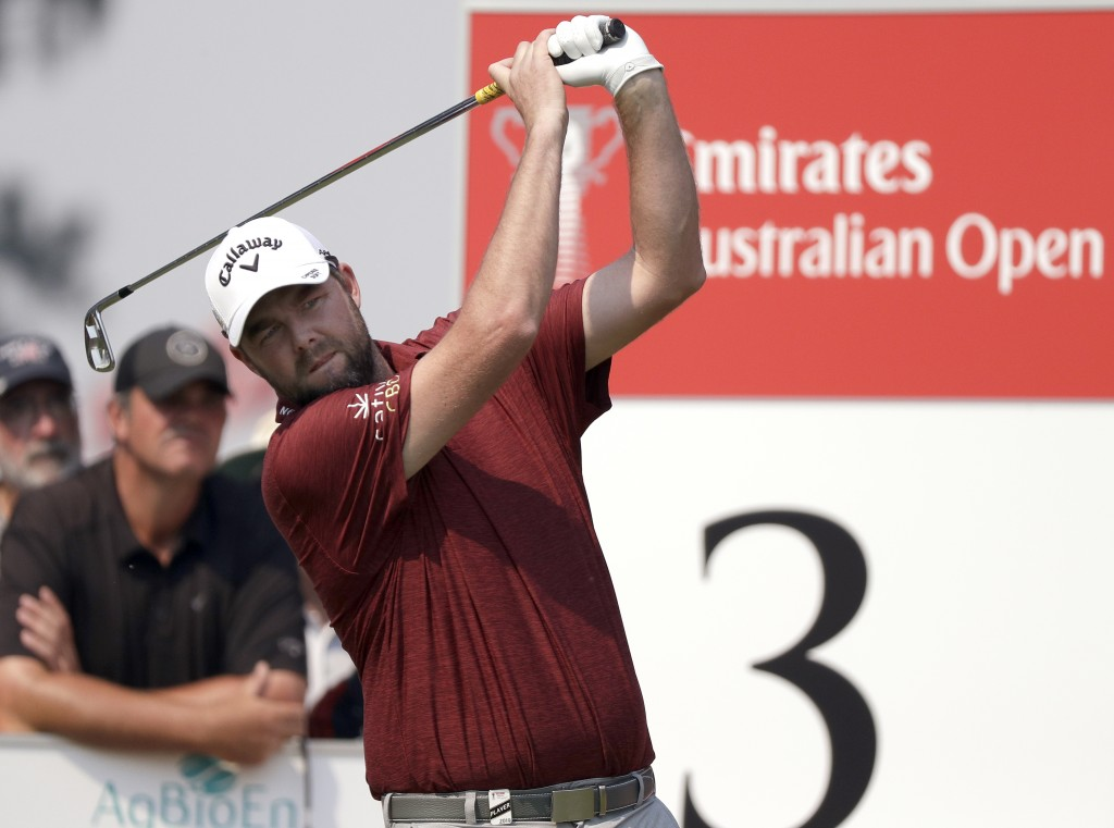 Australia's Marc Leishman tees off on the 3rd hole during the opening round of the Australian Open golf tournament in Sydney, Thursday, Dec. 5, 2019. ...