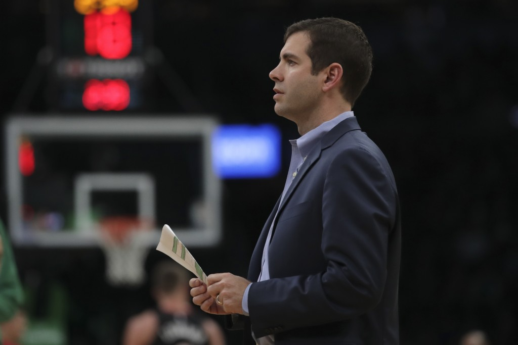Boston Celtics head coach Brad Stevens prepares to draw up a play during a time out in the first half of an NBA basketball game against the Miami Heat...