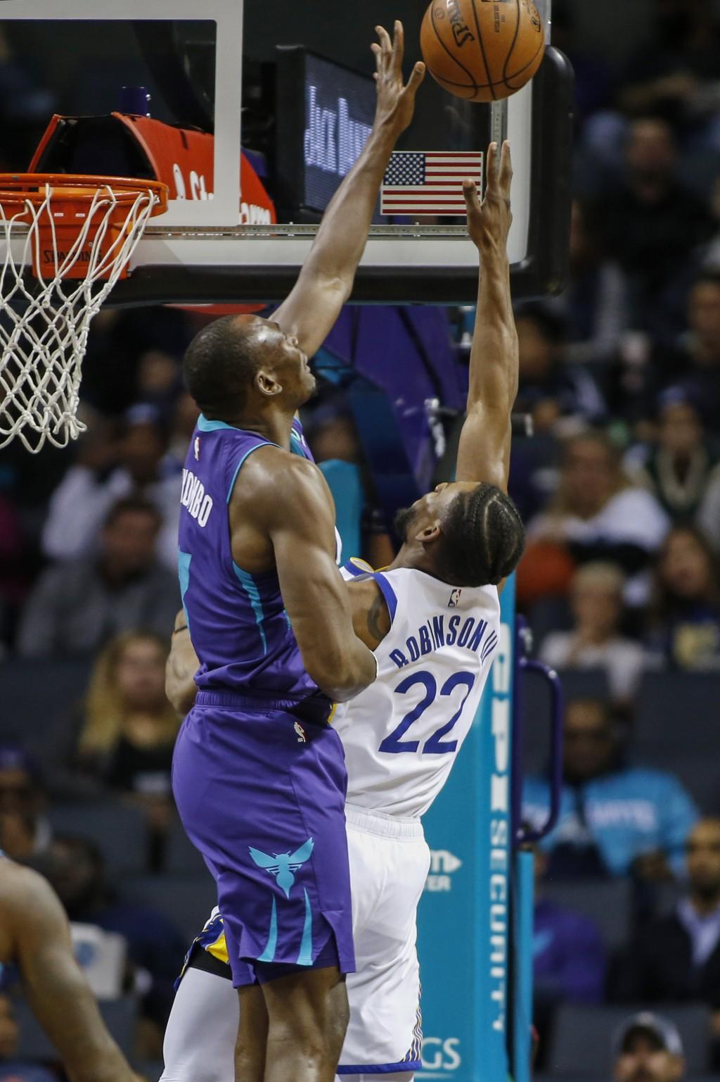Golden State Warriors forward Glenn Robinson III (22) shoots as Charlotte Hornets center Bismack Biyombo defends during the first half of an NBA baske...