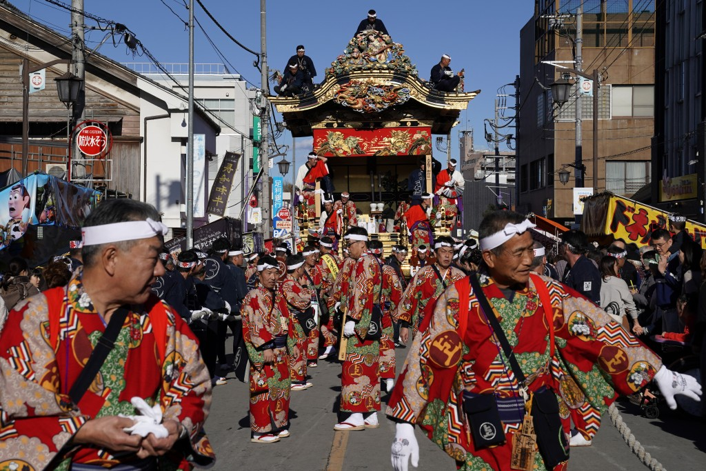In this Tuesday, Dec. 3, 2019, photo, participants clad in kimonos prepare to pull a float before it goes to the town central square at the Chichibu N...