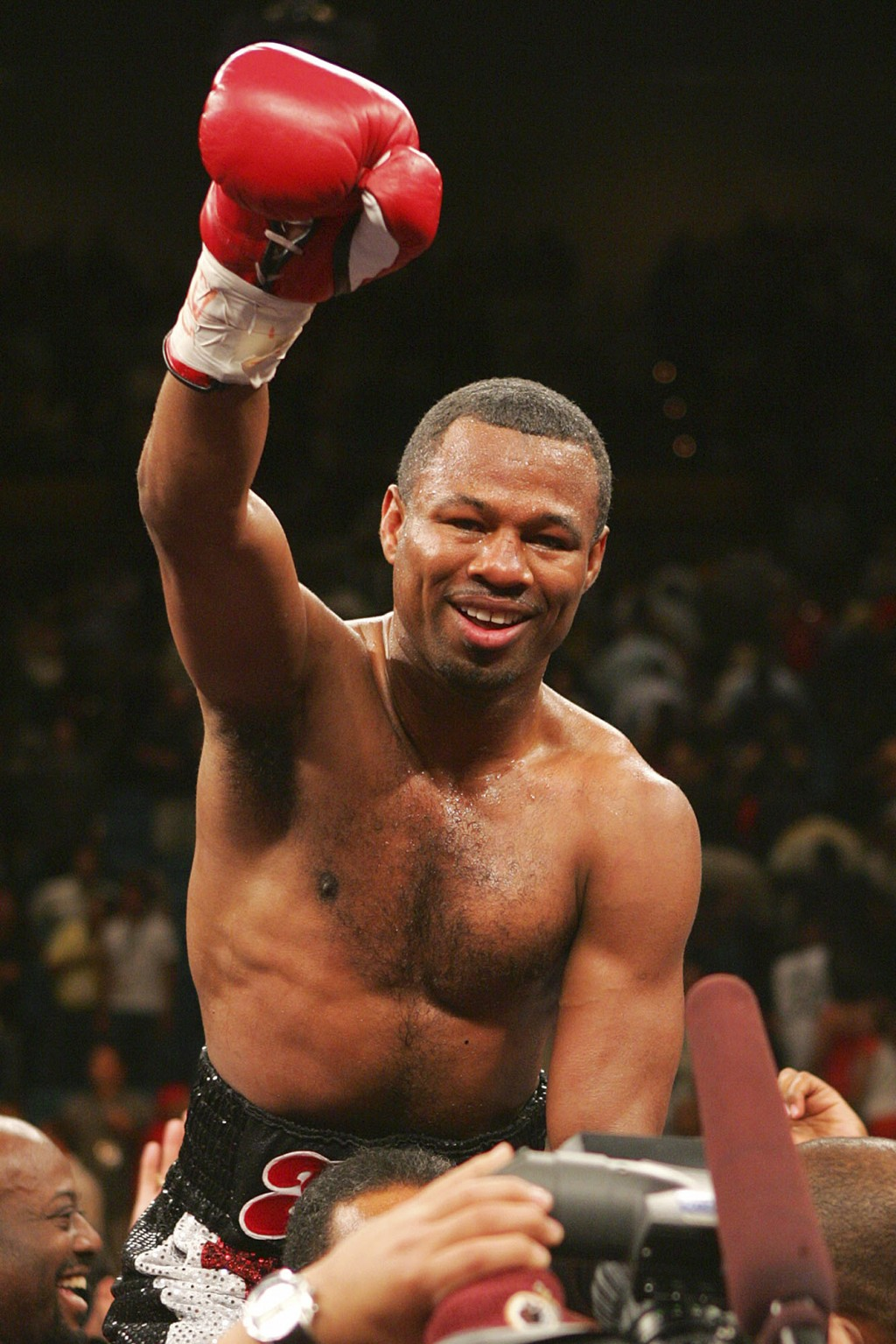 FILE - In this July 15, 2006, file photo, Shane Mosley celebrates his sixth round TKO victory over Fernando Vargas in a junior middleweight boxing mat...