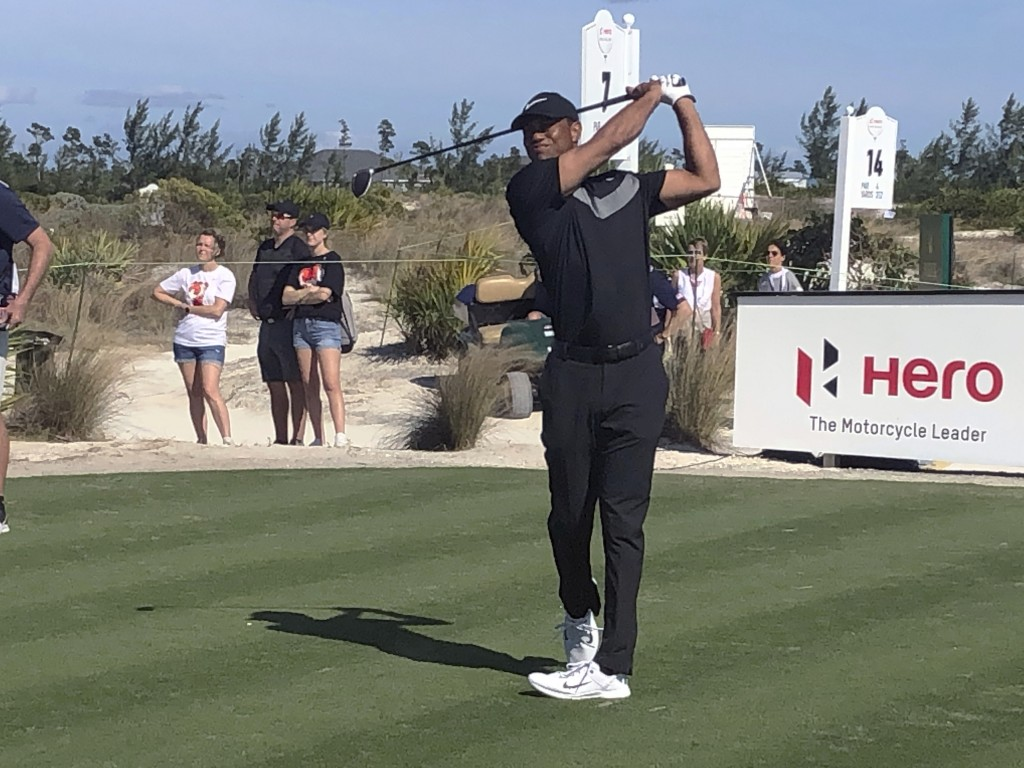 Tiger Woods hits 3-wood off the seventh tee at Albany Golf Club in the first round of the Hero World Challenge on Wednesday, Dec. 4, 2019, in Nassau, ...