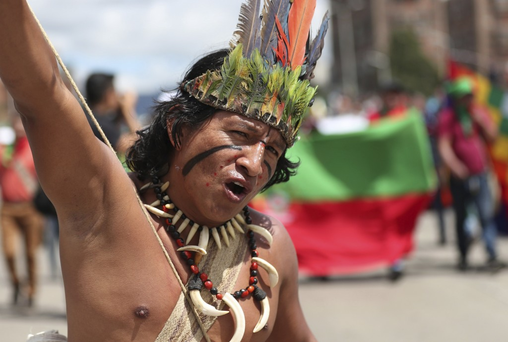 An indigenous man takes part in an anti-government march in Bogota, Colombia, Wednesday, Dec. 4, 2019. Colombia's recent wave of demonstrations began ...