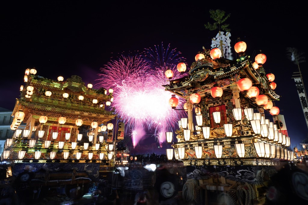 In this Tuesday, Dec. 3, 2019, photo,  lantern-covered floats stand as fireworks light up the sky during the Chichibu Night Festival in Chichibu, nort...
