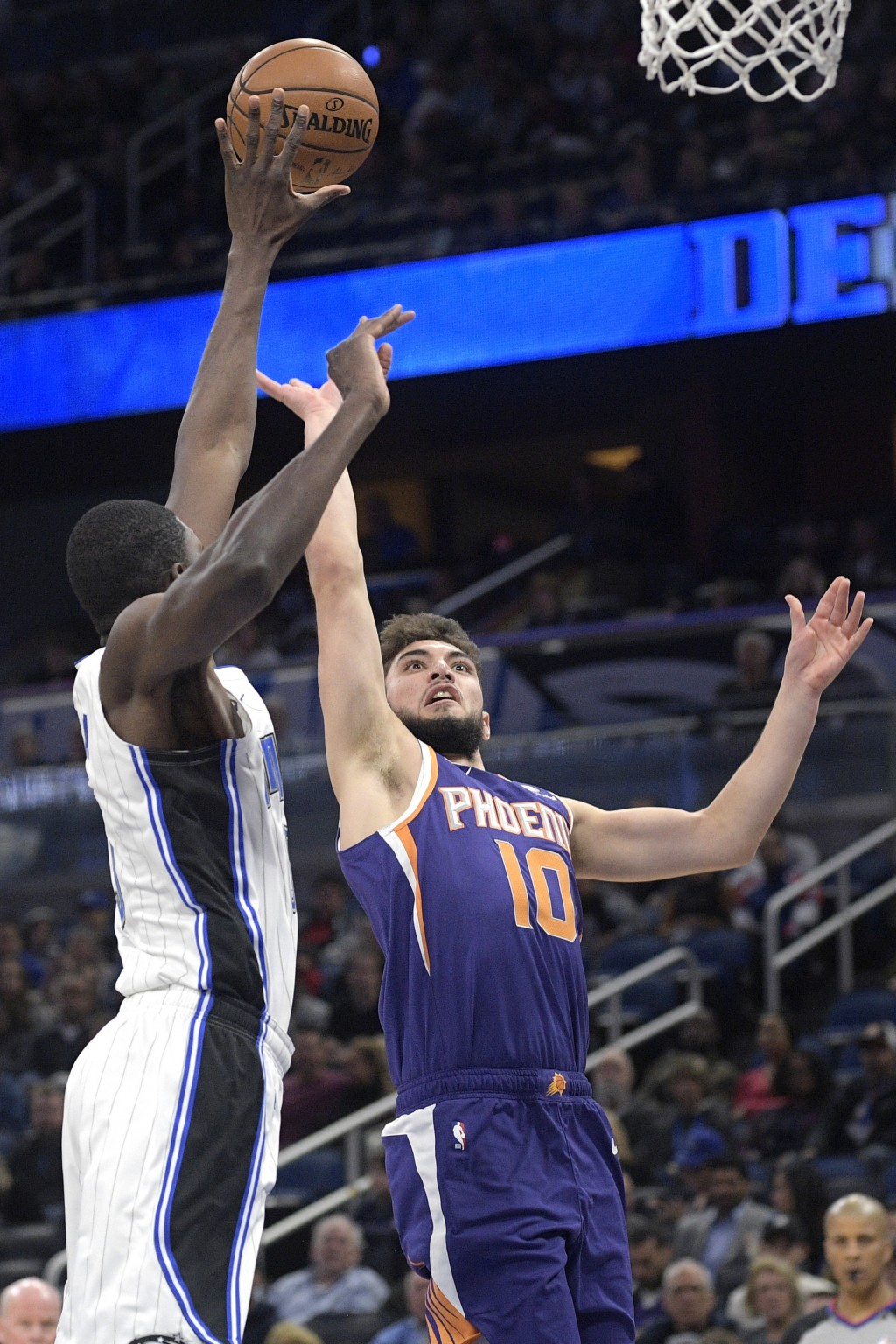 Phoenix Suns guard Ty Jerome (10) goes up for a shot in front of Orlando Magic center Mo Bamba, left, during the first half of an NBA basketball game ...