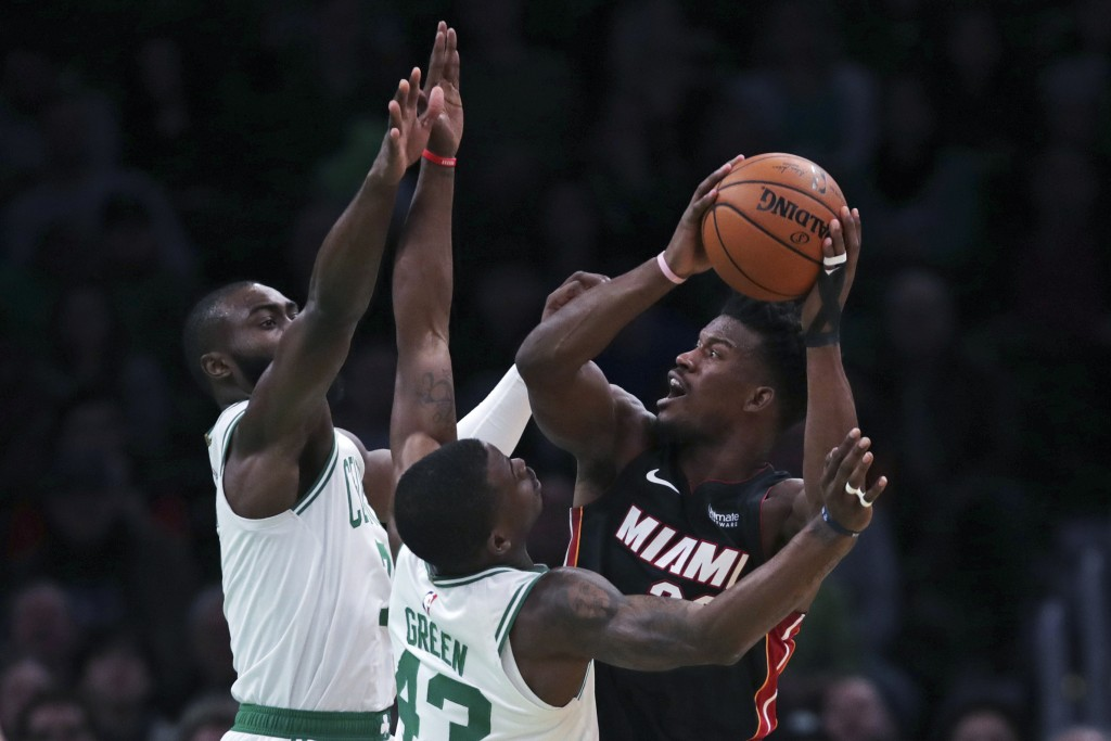 Miami Heat forward Jimmy Butler, right, is covered on his shot by Boston Celtics guard Javonte Green (43) and forward Jaylen Brown, rear left, during ...