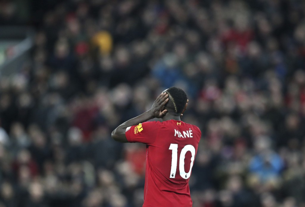 Liverpool's Sadio Mane reacts during the English Premier League soccer match between Liverpool and Everton at Anfield Stadium, Liverpool, England, Wed...