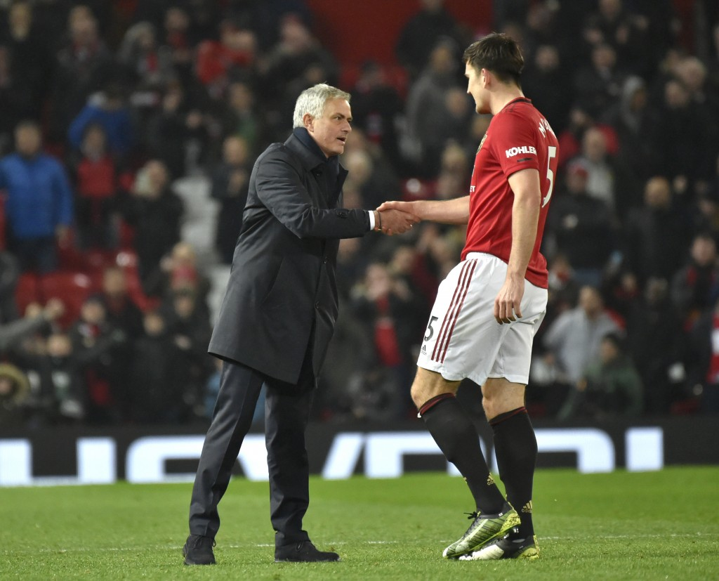 Tottenham's manager Jose Mourinho shakes hands with Manchester United's Harry Maguire the English Premier League soccer match between Manchester Unite...