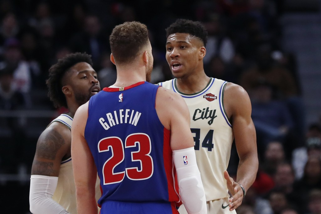 Detroit Pistons forward Blake Griffin (23) and Milwaukee Bucks forward Giannis Antetokounmpo (34) exchange words after a foul on the floor during the ...