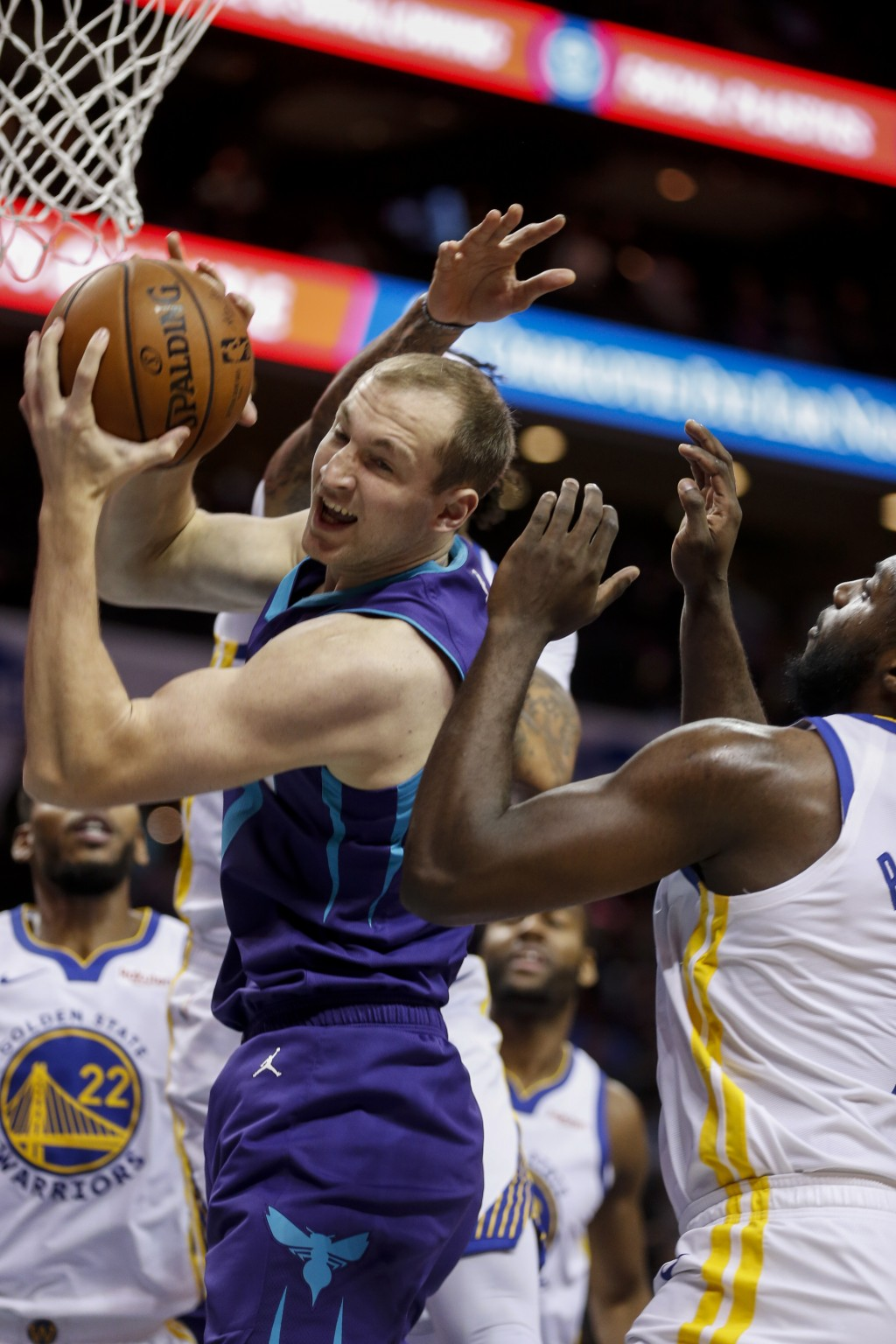 Charlotte Hornets forward Cody Zeller pulls down an offensive rebound during the first half of the team's NBA basketball game against the Golden State...