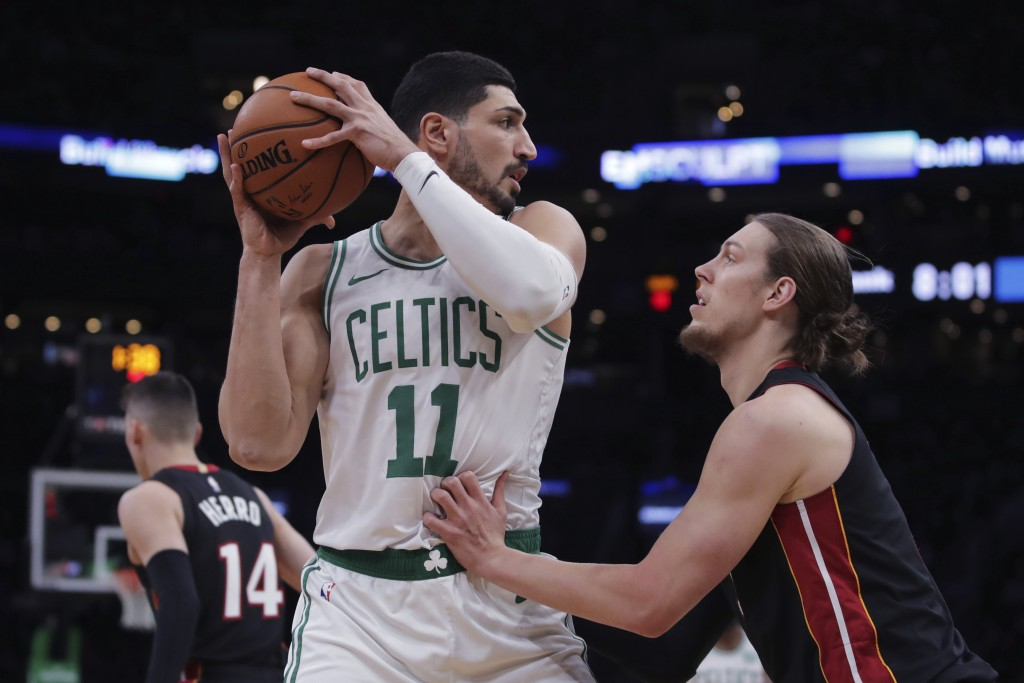 Boston Celtics center Enes Kanter (11) looks to pass as he is covered by Miami Heat forward Kelly Olynyk, right, during the first half of an NBA baske...