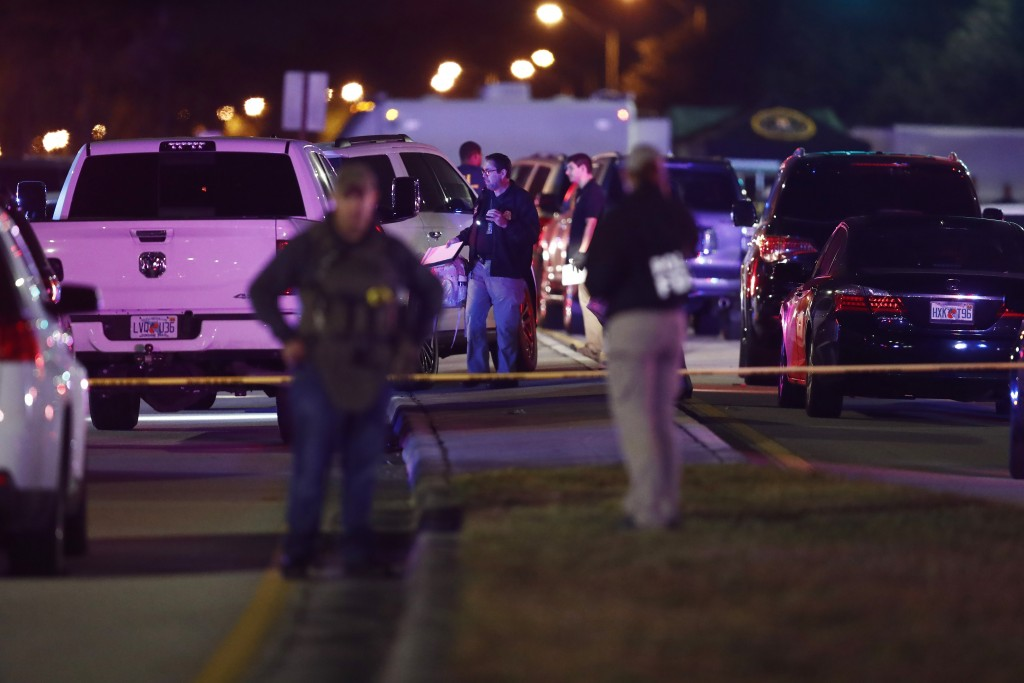Authorities investigate the scene of a shooting Thursday, Dec. 5, 2019, in Miramar, Fla. Four people, including a UPS driver, were killed Thursday aft...