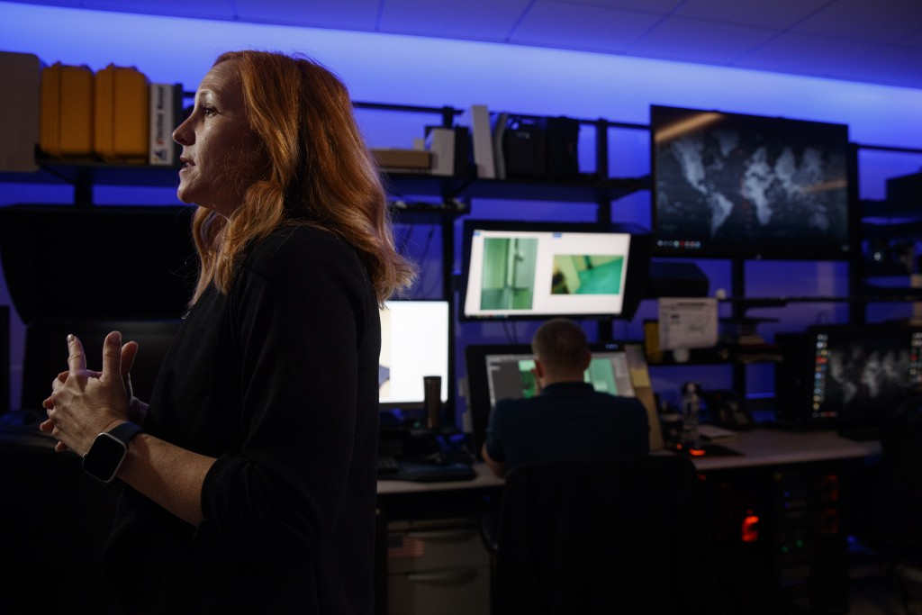 Erin Burke, left, Section Chief of the Child Exploitation Investigations Unit at Homeland Security, is interviewed inside the Victim Identification La...