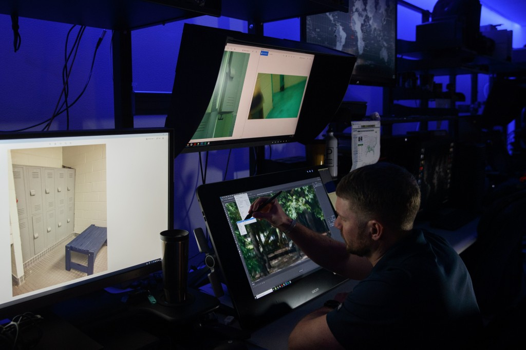 A computer forensic analyst reviews a case inside the Victim Identification Lab, part of Homeland Security's Child Exploitation Investigations Unit, i...