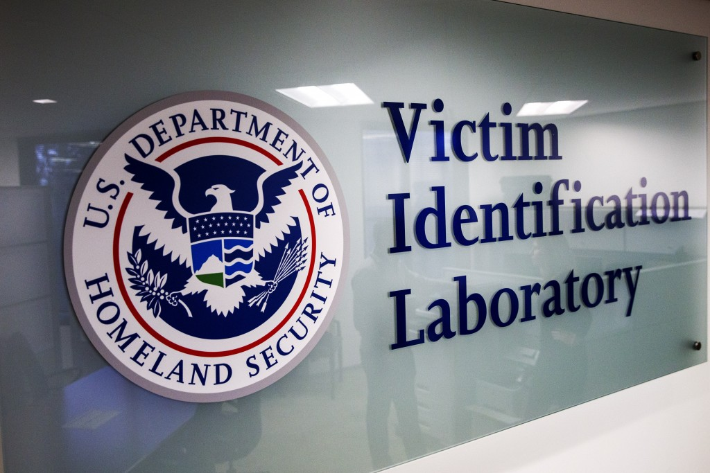A sign to the Victim Identification Lab, part of Homeland Security's Child Exploitation Investigations Unit, is seen in Fairfax, Va., Friday, Nov. 22,...