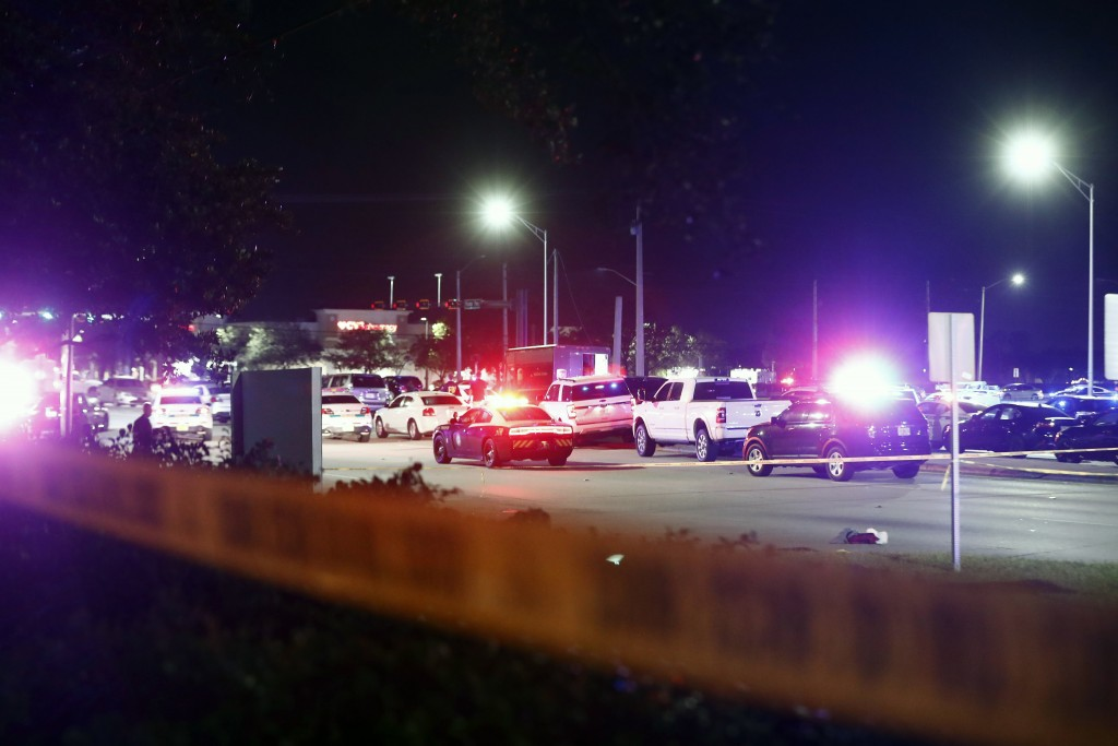 A row of vehicles and a UPS truck are seen behind police tape after a shooting Thursday, Dec. 5, 2019, in Miramar, Fla. Four people, including a UPS d...